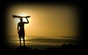 surfing-man-ocean-sun-night-skating-pleasure